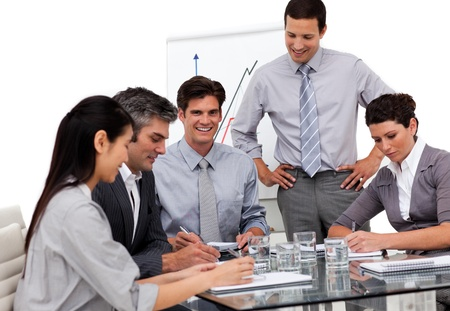Portrait of a multi-ethnic business team having a meeting photo