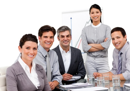 Portrait of a multi-ethnic business team sitting together photo