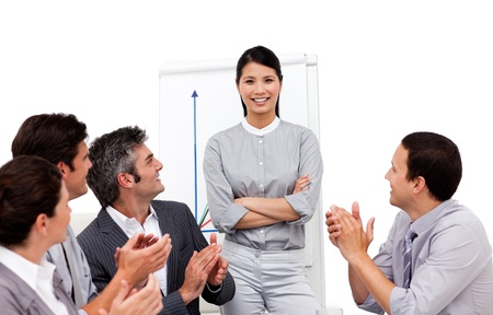 Portrait of a multi-ethnic business team sitting together Stock Photo - 10096325