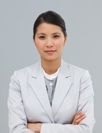 Serious businesswoman with folded arms photo