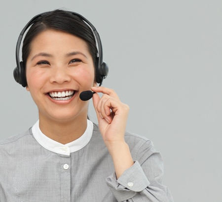 Asian customer service agent with headset on Stock Photo - 10076384