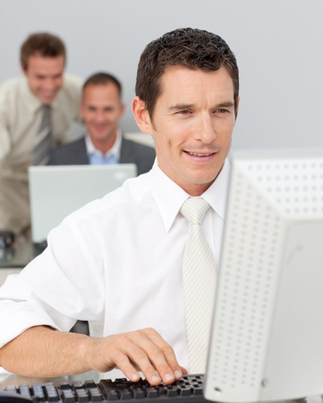 Businessman working with a computer in the office photo
