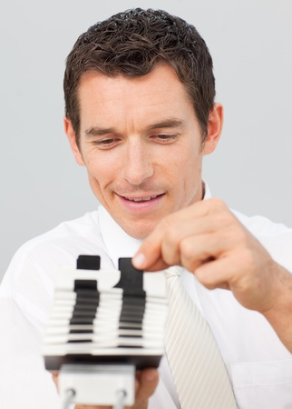 Attractive businessman consulting a card holder photo