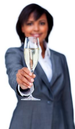 Hispanic businesswoman toasting with Champagne photo
