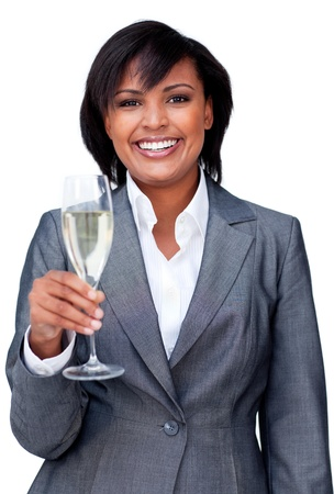 Smiling businesswoman celebrating a success with Champagne photo