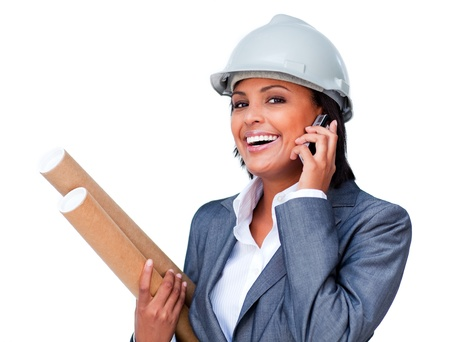 executive helmet: Female architect on phone bringing blueprints  Stock Photo