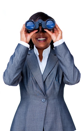 Young hispanic businesswoman using binoculars  Stock Photo - 10077775
