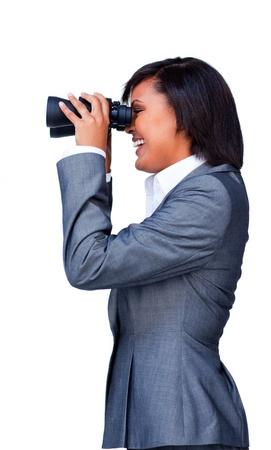 Smiling businesswoman looking through binoculars Stock Photo - 10096413