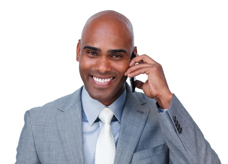 Smiling afro-american businessman on phone photo