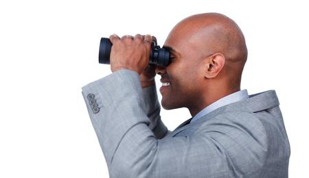Afro-american businessman using binoculars Stock Photo - 10111625