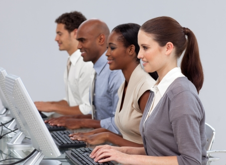 Serious International business team working at computers Stock Photo - 10111776