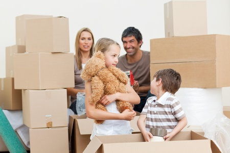 first move: Family unpacking boxes after move in
