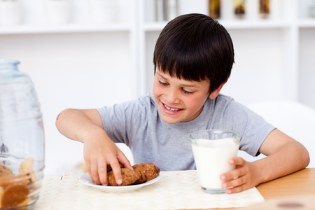 Little boy eating cookies  photo