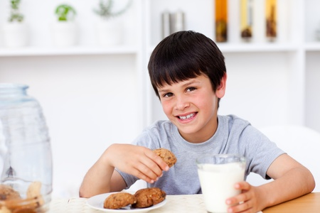Smiling boy eating cookies  photo