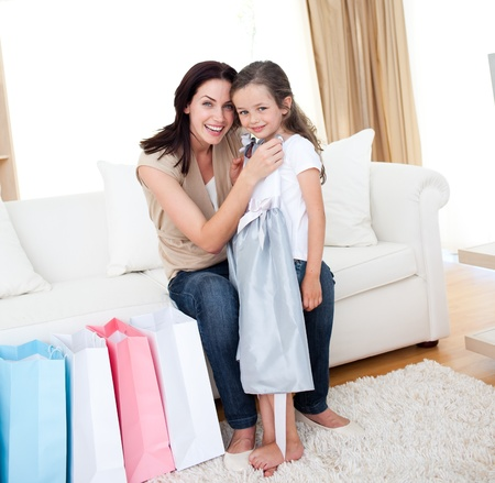Happy mother and little girl after shopping  photo