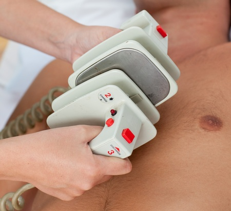 defibrillator: Close-up of a doctor preparing a defibrillation Stock Photo