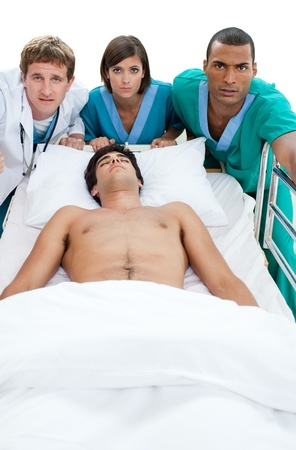 reanimation: Emergency scene: medical team carriyng a patient Stock Photo
