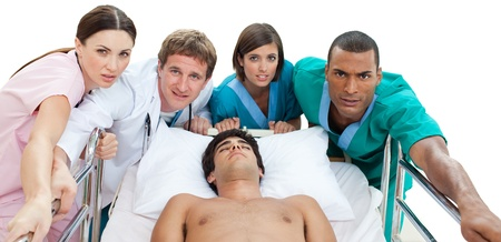 Medical team carrying a patient to intensive care unit Stock Photo - 10111200