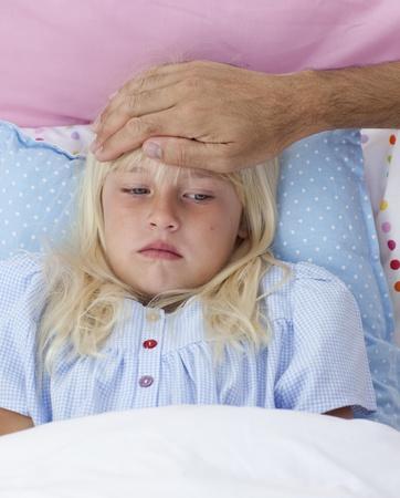 Sick girl in bed having flu photo
