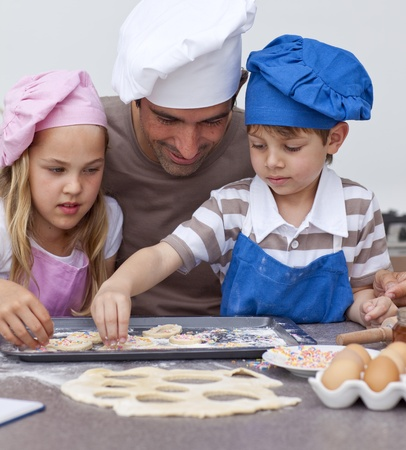 Portrait of father and children baking photo