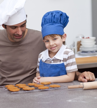Father and son baking in the kitchen photo