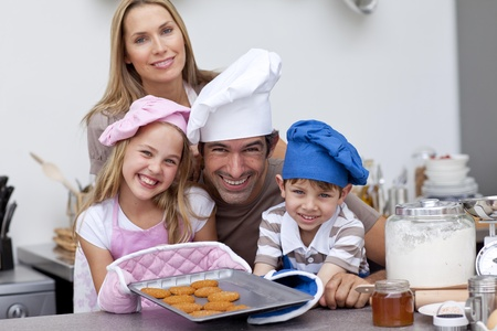 Family baking biscuits in the kitchen photo