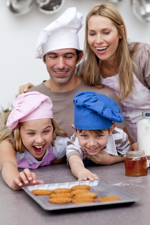 Children and parents eating cookies after baking photo