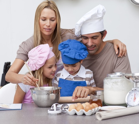 Children baking cookies with their parents photo