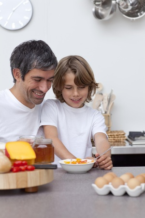Smiling father and son having breakfast together Stock Photo - 10110985