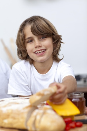 Smiling child eating bread photo
