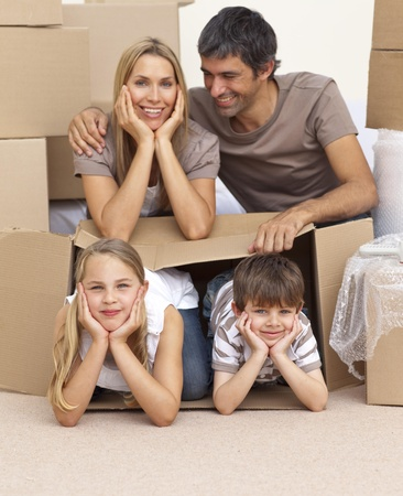 Family moving house playing with boxes photo