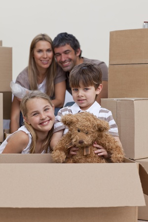 Children unpacking boxes with their parents photo