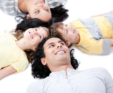 Smiling family lying on the floor together Stock Photo - 10093819