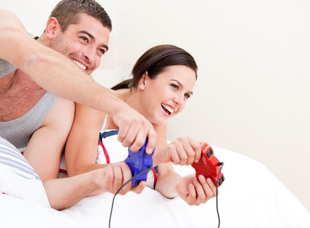 Happy couple playing video games photo