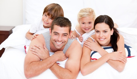 animated adult: Smiling family waching television