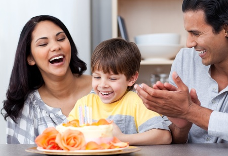 Laughing family celebrating a birthday together Stock Photo - 10096491