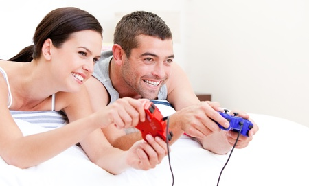 United couple playing video games photo