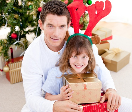 Handsome father celebrating christmas with his daughter photo