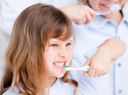 Caucasian girl brushing his teeth  photo