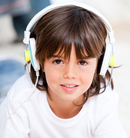 Smiling boy listening music photo