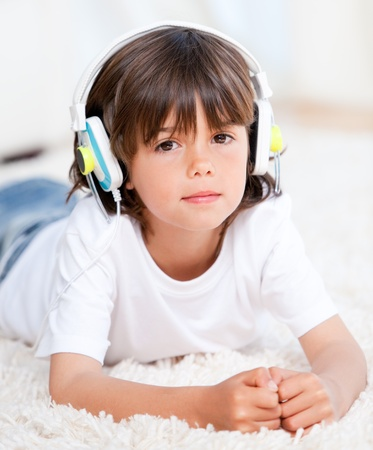 Relaxed boy listenning music photo