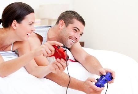 Joyful couple playing video games photo
