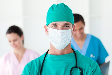 Portrait of a surgeon wearing a surgical mask photo