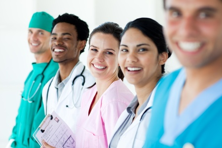 diverse group of people: Smiling medical team in a line Stock Photo