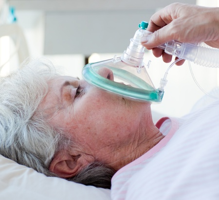Close-up of a female patient receiving oxygen mask