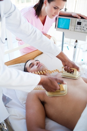 Medical team resuscitating a patient photo
