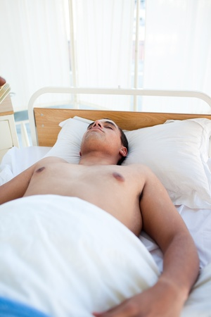 Young patient lying on a hospital bed photo