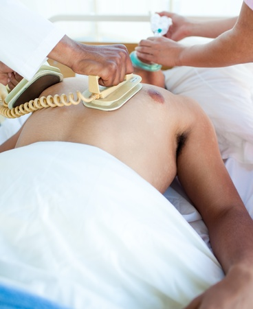rhythms: A doctor performing a CPR on a patient Stock Photo