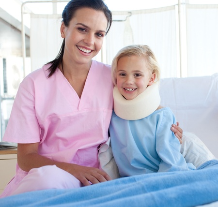 A nurse and her patient smiling at the camera  photo