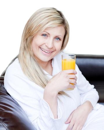 jus: Smiling woman drinking an orange jus  Stock Photo